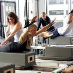 """What Is the Most Essential Pilates Apparatus? Lately we've been talking a lot about apparatus in the Dynamic Fitness blog -- the cornerstones of the classical Pilates studio, accessories to amplify your practice, and even some crazy gadgets that never made it off the drawing board -- but it's time that we acknowledge the single most important apparatus in the whole Pilates method. It doesn't demand an expensive purchase or a lot of extra workout space. It's completely portable and even washable (although we don't recommend dry cleaning).  It's used in every single Pilates exercise, from footwork to breathwork and everything in between. Figured it out yet? ... It's your body.Perhaps this is best exemplified in the famous Pilates """"mat class,"""" which in some studios takes the spotlight over the apparatus themselves.  Pilatesology (https://pilatesology.com ), one of our favorite wellsprings of Pilates knowledge, describes mat-work as """"the purest form of Pilates,"""" since it was developed by founder Joseph Pilates long before the Cadillac and Reformer emerged from his imagination. Stretched out on the mat, you feel gravity's full effects on every muscle in your body. Using the weight of your own limbs to work against a literal force of nature helps your muscles develop strength holistically. That is, you're not focused on """"shredding"""" vanity muscles; instead, your muscle groups work together in an integrated way. When you raise your arms or extend the legs, you're training the deep muscles that align the spine. And of course, every exercise goes back to the core, with an intent focus on quality of movement over quantity of motions. Yes, the mechanical apparatus get a lot of attention, and that's because they are pretty amazing examples of fitness design. Joseph Pilates developed most of them specifically for his method, and they've remained virtually unchanged for 80 years or so. At Dynamic Fitness, our goal is to offer the Sarasota community an unparalleled resource for cla"""