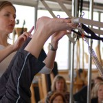"""Pilates Mythbusters: Any Fitness Instructor Can Teach Pilates Just by Taking Classes Themselves In the last installment of our quest to dispel common misconceptions about Pilates, we're going to focus on the teachers who are out there working in studios and gyms.Over the past 20 years, the popularity of Pilates has escalated the demand for instructors; thus many """"fast Eddie""""-type certification programs have sprung up. These inadequate programs teach only the minimum of what one needs to know about the system, and after several weekend training sessions an instructor will emerge with a certificate in hand. Buyers beware! The result is that their future clients will get what the instructors paid for... and that isn't much!In order to be sufficiently trained to teach the classical method (as Joe intended it to be), an instructor will spend a minimum of 600 hours as an apprentice and pass rigorous written and practical exams. Romana Kryzanowska, who started studying with Joseph Pilates in 1941, had a direct hand in educating all of the classical Pilates master teachers, who now pass on Joe's knowledge and legacy to current apprentice instructors -- who will in turn pass it on. This certification process prepares the apprentice to understand the system and teach a classically-based, integrated, systematic workout that utilizes both the mat exercises and the full range of advanced apparatuses. Furthermore, a certified Pilates instructor will be able to advance their clients and challenge them as appropriate to each individual. To that end, apprentices study the history of the method, basic anatomy, and modifications for clients who have special needs. This encompasses the needs of women working out during and after pregnancy, to physical therapy patients who are returning to a regular workout regimen. When taught by a knowledgeable teacher, all clients of all ages and fitness levels will benefit equally.When Pilates is taught as its creator Joseph Pilates intended, the re"""