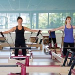 "Pilates for Busy People (All of Us?) It's a given in our world: We are busy people. With 40-hour-a-week jobs, presentations to give, children's carpool lines and after-school activities, meals to prepare, bills to pay, cars to get fixed, houses to clean, laundry to fold -- you get the picture -- there's little time left to think about ourselves, our bodies, the way we move through the world. What if there were an activity you could fit into your busy schedule that would not only help you to stay in shape, but carry its benefits into your daily life, boosting your energy, confidence, and stamina so that you don't collapse in a heap on the bed after a full day?Well, there is! Even one Pilates studio session per week will leave you feeling invigorated, stronger, and more sane so that you can be your best self all week long.  Because the Pilates method requires focused attention, deep breathing, and whole-body engagement, busy people (let's face it, we're all busy) will reap its benefits. The mind-body connectionWhen Joseph Pilates said, ""A body free from nervous tension and fatigue is the ideal shelter provided by nature for housing a well balanced mind, fully capable of successfully meeting all the complex problems of modern living,"" he was explaining how the Pilates method affects daily life. With regular Pilates practice, students become more aware of posture, breath, and core strength. Whether you're writing a memo at a desk or cooking dinner, you will begin to feel the proper way for your body to move throughout the day, a knowledge that retrains the mind to expect alignment and health. Frequency of workoutsExperts say that no matter what exercise you try, it's optimal to engage in it two to three times a week. The same is true for Pilates. Joseph Pilates said, ""In 10 sessions you will feel the difference, in 20 you will see the difference and in 30 you will have a whole new body."" Consistency of practice is important: Once a month at the Pilates studio will not only be less beneficial, but you'll get frustrated that you can't remember what you learned in your previous sessions. Workouts are designed as building blocks from beginner to advanced fitness levels. As they engage different levels of concentration -- from proper breathing, to specific muscle groups, to the flow from one exercise to another -- it's important to find a regular routine. Once a week will give you a boost. Two or three times a week will garner greater, and faster, change. What else can I do?When you can't get to the studio, what else might you do? Many Pilates instructors actually give their clients homework, often consisting simply of conscious practice in proper posture and breathing. Ask your instructor what you can do throughout the day to maintain your workout's benefits. You'll be surprised: You may not even have to leave your desk!Adding aerobic exercise is also beneficial -- even taking a brisk walk around the neighborhood after dinner can get your blood pumping, as will a jog. Adding stretches to your morning or before-bed routine can keep you aware and limber. Remember, physical exercise isn't just for people who don't have kids, careers, or lives outside the gym or studio. It's important for all of us to stay in physical, mental, and emotional shape so that our busy lives can feel enriching versus constantly exhausting. Pilates is an excellent way to bring your workout home with you, and to train your body to expect its benefits throughout the day."